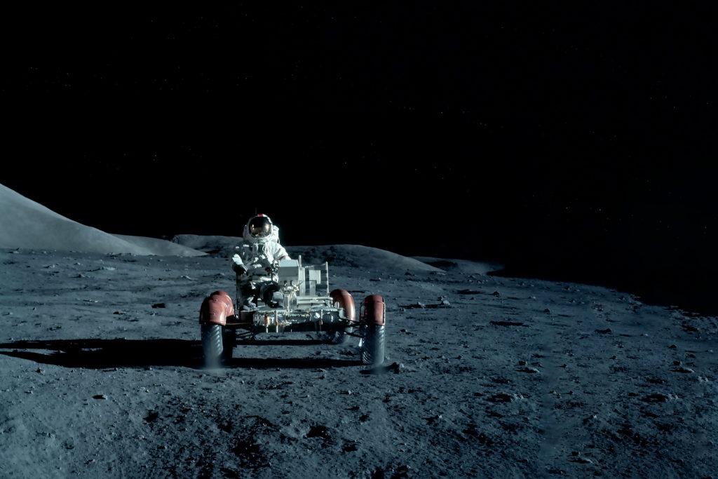 Astronaut on a moon rover.
