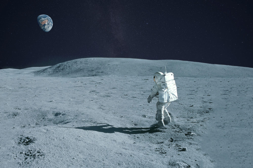 Astronaut walking on the moon.
