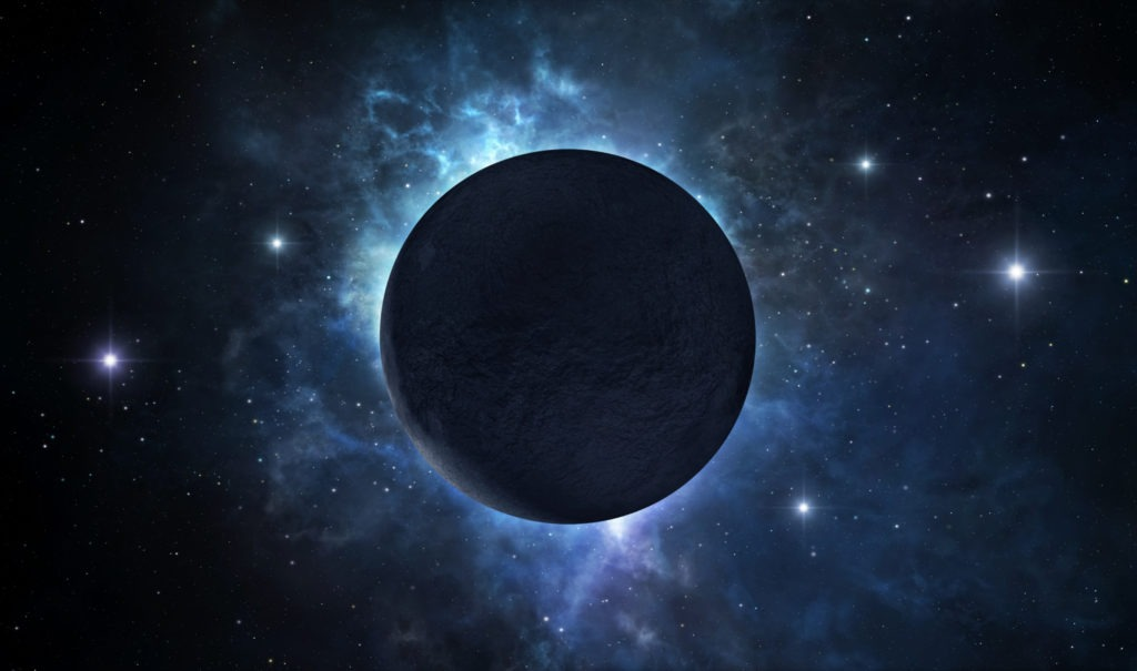 A picture of dark deserted planet located somewhere in deep space.