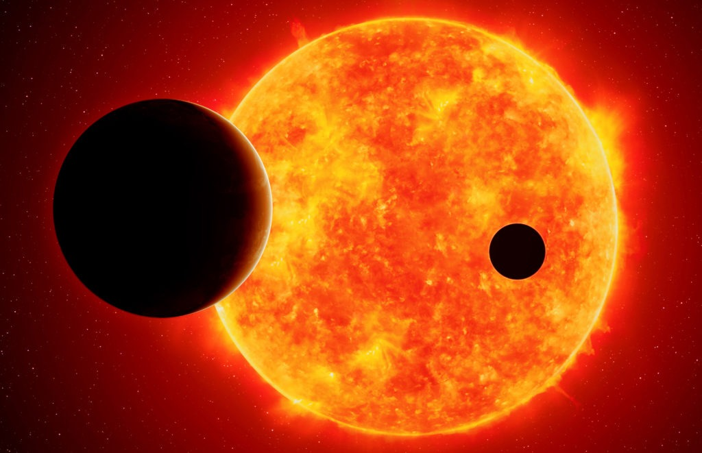 Two exoplanets against red dwarf.