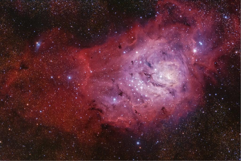 Lagoon nebula in purple and red hues.