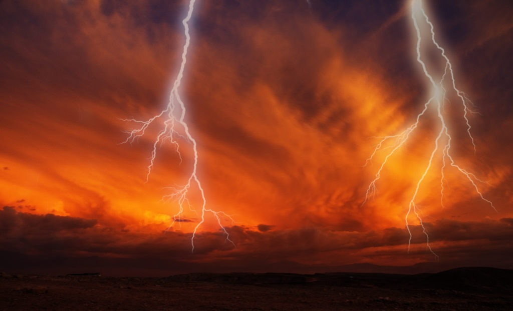 Lightning on a dark orange atmosphere.