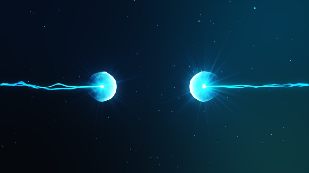 Two particles ready to collide with one another.