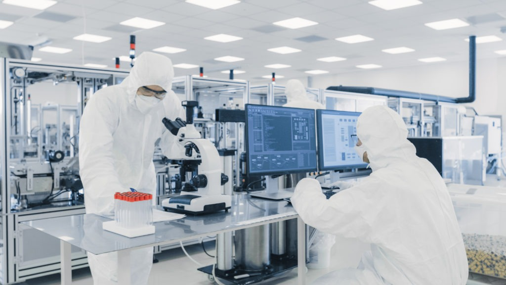 Equipped research scientists in modern laboratory.